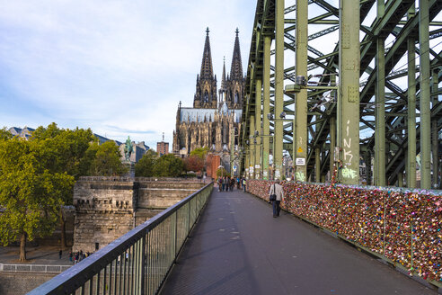 Cologne Hohenzollern bridge and the Cologne Cathedral in the background early in the morning - TAM01323