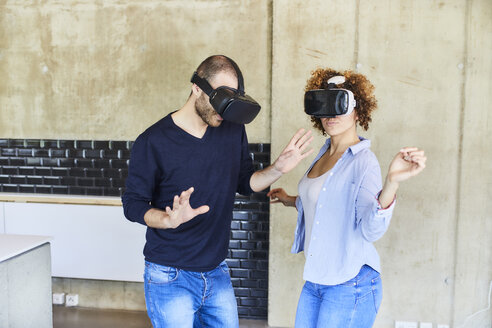 Man and woman wearing VR glasses moving - FMKF05623