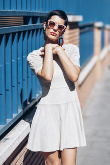 Fashionable young woman wearing dress and sunglasses - JSMF00971