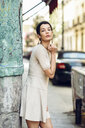 Portrait of fashionable young woman wearing a dress in the city - JSMF00977