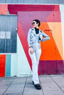 Fashionable young woman posing with colorful urban background - JSMF01016