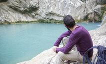 Greece, Messenia, man watching the Polylimnio waterfalls near Kazarma - MAMF00601