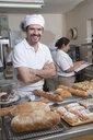 Hispanic baker working in commercial kitchen - BLEF00136