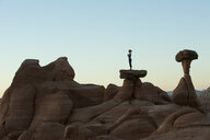 Caucasian woman practicing yoga on top of rock formation - BLEF00166