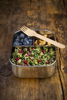 Lunchbox with bulgur herbs salad with pomegranate seeds, taboule, blueberries and trail mIx - LVF07975