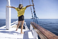 Indonesia, Komodo National Park, girl on a sailing boat - MCF00120