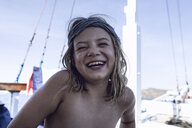 Indonesia, Komodo National Park, portrait of laughing girl on a sailing boat - MCF00132