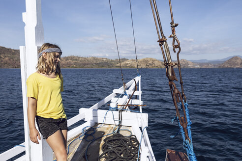Indonesia, Komodo National Park, girl on a sailing boat - MCF00135