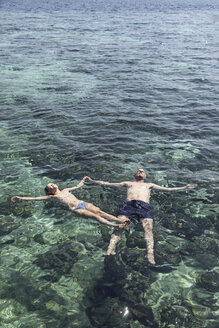 Indonesia, Komodo National Park, father and daughter floating in the sea - MCF00144