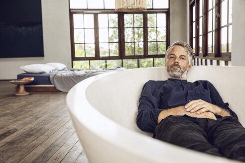 Man lying dressed in bathtub - MCF00159
