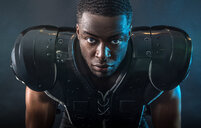 Portrait confident, tough football player wearing pads - CAIF23286