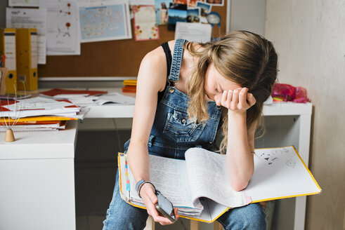 Tired, stressed female college student studying - CAIF23310