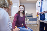 Doctor talking with patients in doctors office - CAIF23359