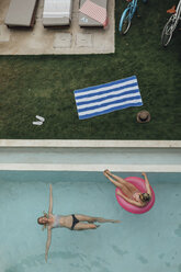 Two young women relaxing in swimming pool - LHPF00686