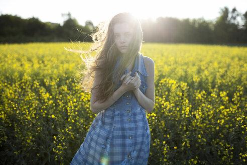 Portrait of Caucasian woman standing in windy field - BLEF00428