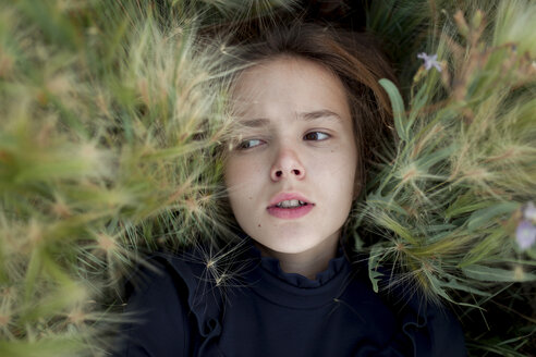 Concerned Caucasian girl laying in field - BLEF00452