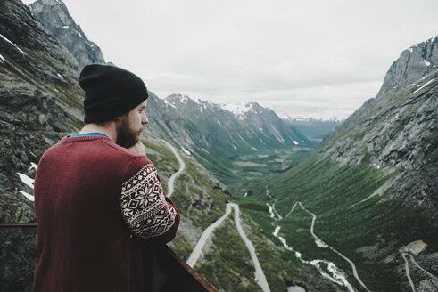Caucasian man admiring scenic view of valley - BLEF00557