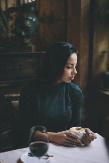 Pensive Caucasian woman drinking coffee - BLEF00590