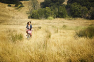 Caucasian woman riding bicycle in field - BLEF00635