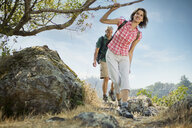 Couple hiking near tree - BLEF00638