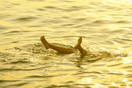 Feet of Caucasian boy sticking out of water - BLEF00779