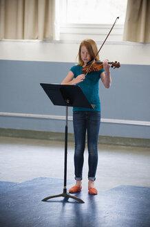 Caucasian girl practicing violin - BLEF00788