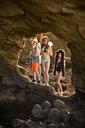 Portrait of Caucasian boy and girls hiking on rocks at beach - BLEF00866
