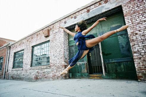Mixed race woman dancing ballet in city - BLEF00962