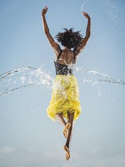 Water spraying on black woman ballet dancing - BLEF01004