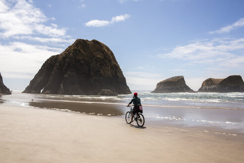 Caucasian woman riding bicycle on beach - BLEF01055