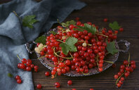 Red berries and leaves on tray - BLEF01163