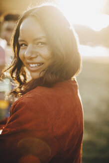 Close-up portrait of smiling young woman on sunny day - MASF12081