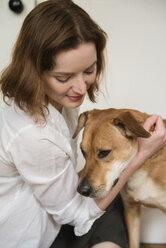 Caucasian woman hugging dog - BLEF01184