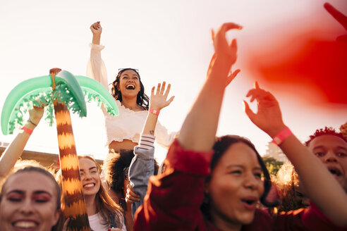 Happy young enthusiastic fans enjoying in music festival - MASF12174