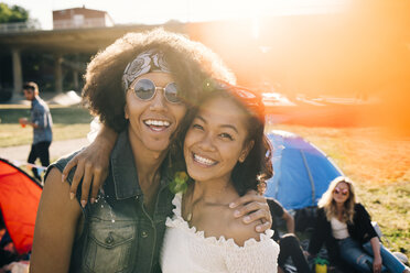 Portrait of smiling friends enjoying at music festival during summer - MASF12219