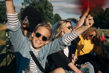 Happy young man enjoying with friends in music festival - MASF12234