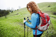 Caucasian woman hiking with walking sticks - BLEF01395