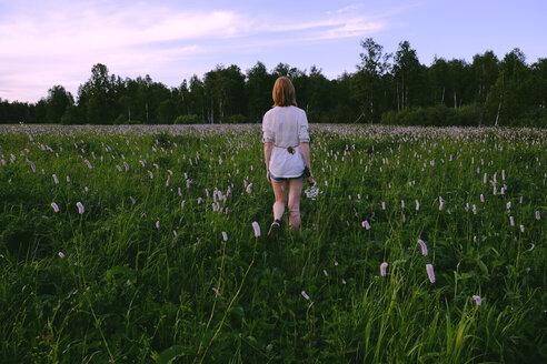 Woman walking in field - BLEF01611