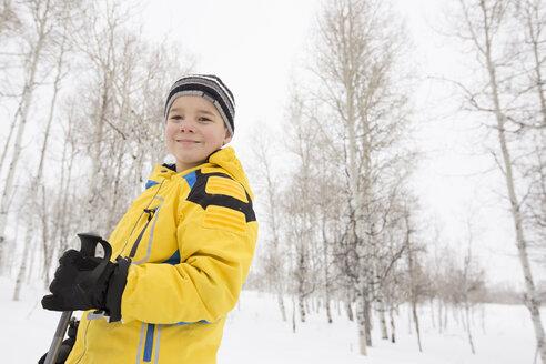 Portrait of smiling Caucasian boy in winter - BLEF01671
