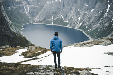Caucasian man admiring scenic view of mountain lake - BLEF01674