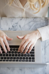 Hands of Caucasian woman typing on laptop - BLEF01785
