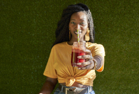 Young woman with dreadlocks holding a smoothie - VEGF00130