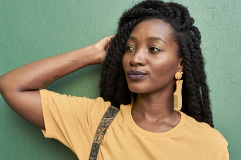 Portrait of young woman with nose piercing and dreadlocks - VEGF00133