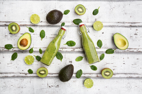 Two bottles of green smoothie with avocado, spinach, kiwi and lime - LVF07993