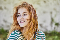 Portrait of redheaded young woman with freckles - FMKF05666