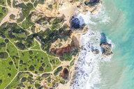 Portugal, Algarve, Lagos, Ponta da Piedade, aerial view of beach, rocky coastline and sea - MMAF00919