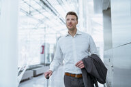 Businessman with baggage at the airport - DIGF06919