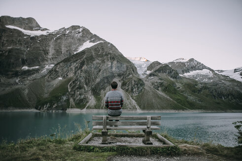 Caucasian man admiring scenic view of mountain lake - BLEF02028