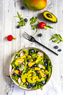 Bowl of rocket salad with mango, avocado, red radishes and blueberries - SARF04248