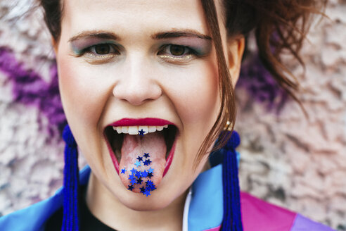 1980s retro-styled woman with stars on tongue - JUBF00348